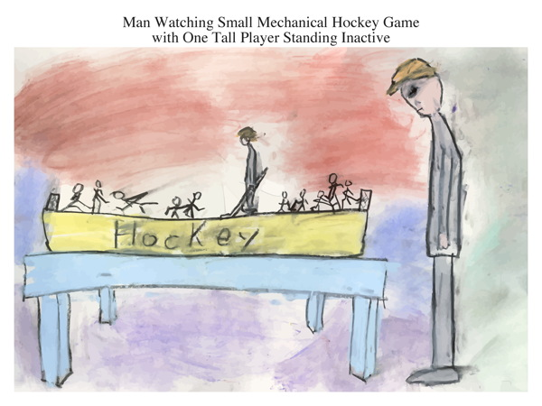 Man Watching Small Mechanical Hockey Game with One Tall Player Standing Inactive